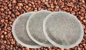 http://www.dreamstime.com/royalty-free-stock-image-coffee-pads-over-coffee-beans-image2681756